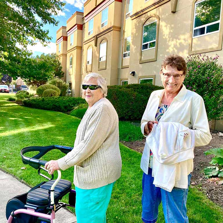 orchard gardens our story our values happy senior residents smiling in garden